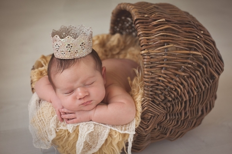 newborn girl with crown photo