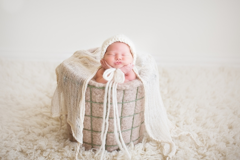 newborn baby girl session with baskets and wool fillers